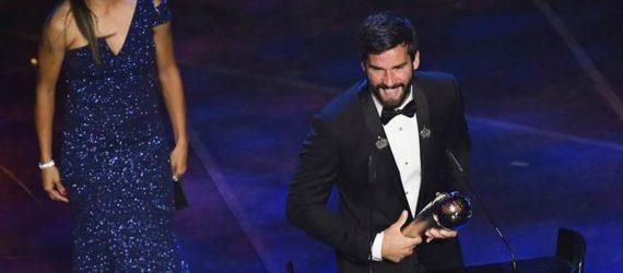 Cássio Manga – Charge do melhor goleiro do mundo: Alisson